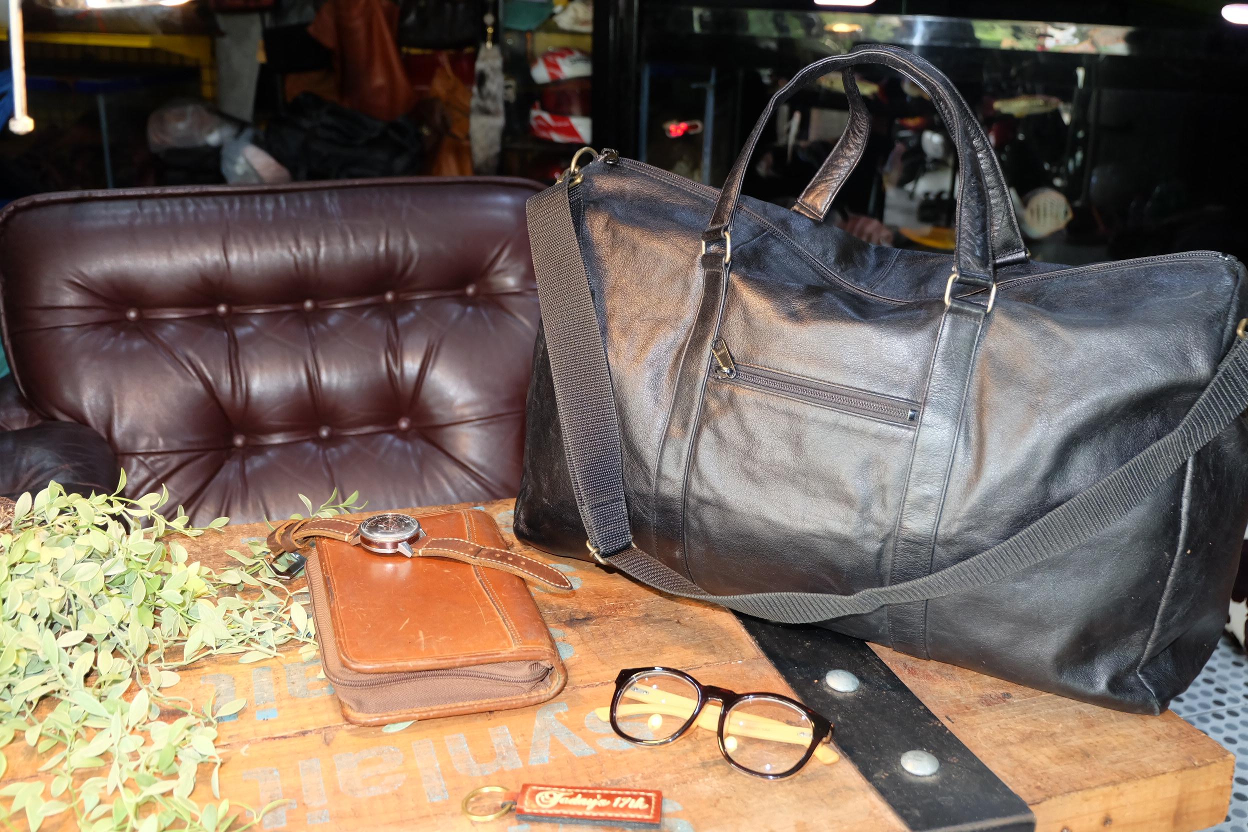 กระเป๋าเดินทางหนังแท้